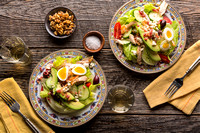 Picture of two dishes with a cobb salad